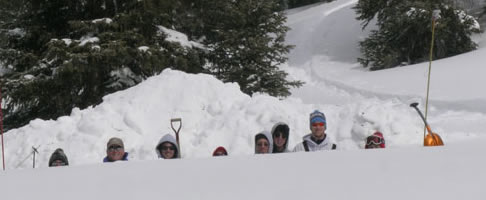 Dr. Friend (second from left) and students in a snowpit.
